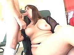 Chubby brunette girl sucking cock
