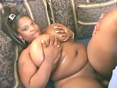 Plump ebony w huge boobs tempts man