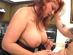 Busty plump milf sucking in kitchen