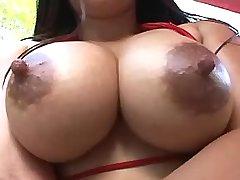 Hot asian girl present massive tits