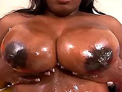 Chubby ebony cutie shows huge boobs