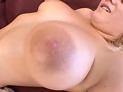 Hot chesty blonde titsfucks on sofa