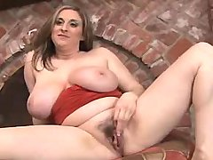 Chesty mature plays with huge boobs