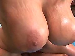 Chesty beauty rides big cock in bed